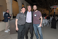 From left, Chase Young '03, Coach Brian Newhall '83 and Finn Rebassoo '03<br /> Now in his 30th year as Oxy's head men's basketball coach, Brian Newhall received a much deserved celebration with a surprise halftime ceremony and post game reception in the Booth Hall courtyard with more than 70 former and current players from all different generations and decades in attendance, on Saturday, Jan. 26, 2019.<br /> Newhall is the winningest coach in Oxy history and has a 100 percent graduation rate in his 30 years at the helm of the program. His resume boasts multiple SCIAC Championships and NCAA Playoff appearances, along with a run to the NCAA Division III Elite Eight in 2003 and the only perfect 14-0 season in SCIAC history. Newhall has not only coached at Oxy, but was a SCIAC Champion and SCIAC Player of the Year during his playing career at Oxy in the early 80s.<br /> (Photo by Marc Campos, Occidental College Photographer)