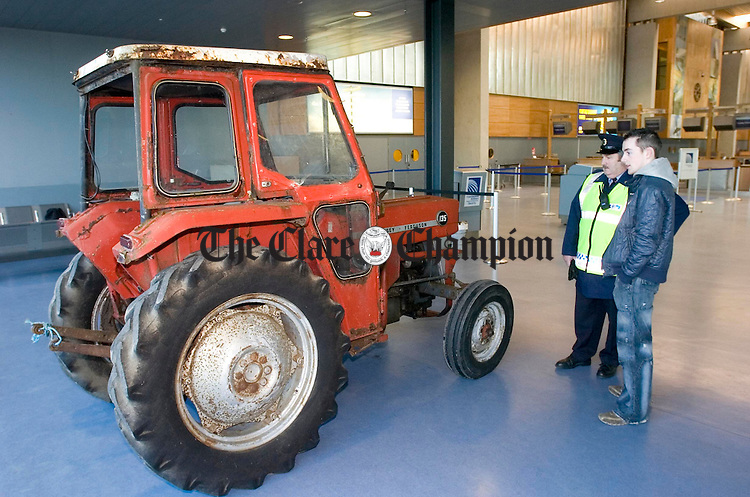 Tony Martin steers a 1968 Masey Ferguson 135 tractor into position in the Shannon Airport terminal building for LSAD student Clive Moroney's installation as part of Arrivals 2006. Photograph by John Kelly.