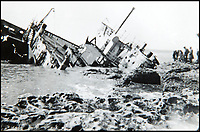 BNPS.co.uk (01202 558833)<br /> Pic: BNPS<br /> <br /> A shipwreck on the beach in La Panne.<br /> <br /> Haunting photos which capture the trail of devastation left in the wake of the Dunkirk evacuation have been unearthed after 77 years.<br /> <br /> The poignant pictures were taken soon after 330,000 Allied troops had been rescued from the beaches by an armada of little ships having been defeated by the Germans.<br /> <br /> The epic operation is about to be the subject of the new Hollywood blockbuster movie 'Dunkirk' will stars Tom Hardy and Harry Styles and is die for release on July 21.<br /> <br /> The black and white snaps show German soldiers surveying the wreckage which included destroyed ships and large military trucks lying in the surf.<br /> <br /> They are being sold by Duke's Auctioneers.