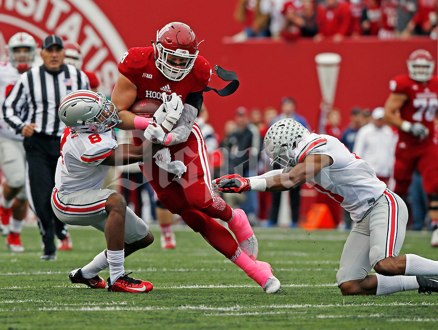 Indiana Hoosiers tight end Anthony Corsaro (88) gains against Ohio State Buckeyes cornerback Gareon Conley (8) and Ohio State Buckeyes safety Vonn Bell (11) in the first of the Ohio State Buckeyes against the Indiana Hoosier at Memorial Stadium in Bloomington Indiana Oct. 3, 2015.(Dispatch photo by Eric Albrecht)