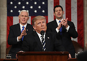 US President Donald J. Trump reacts after delivering his first address to a joint session of Congress from the floor of the House of Representatives in Washington, DC, USA, 28 February 2017.  Traditionally the first address to a joint session of Congress by a newly-elected president is not referred to as a State of the Union.<br /> Credit: Jim LoScalzo / Pool via CNP
