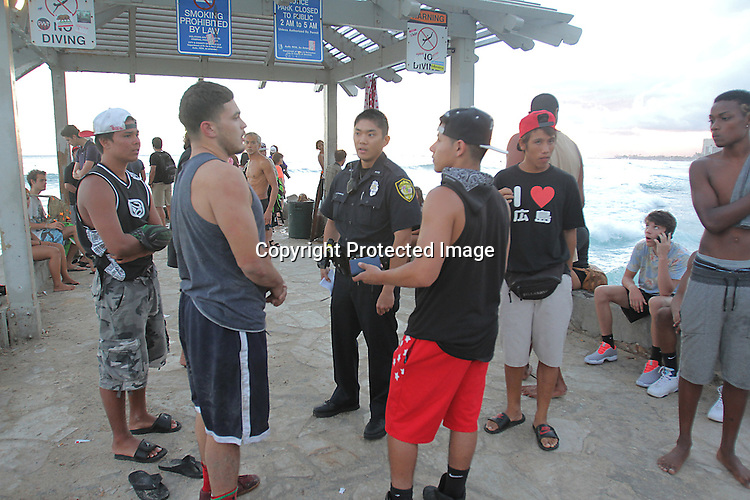 """Honolulu Police respond to a incident at the """"Wall"""" at Waikiki."""