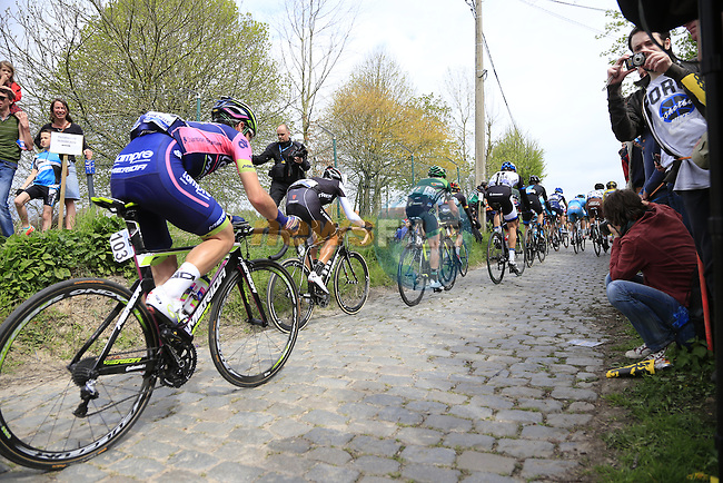 The peleton climb the Molenberg during the 2014 Tour of Flanders, Belgium.<br /> Picture: Eoin Clarke www.newsfile.ie