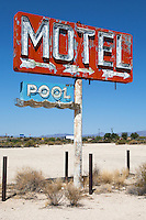 Sign for a Motel with a  pool along Route 66 in Yucca, Arizona, that no longer exists.