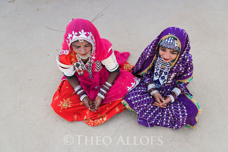 Rajasthani dancers wearing colorful, traditional costumes and jewelry, Thar Desert, Rajasthan, India --- Model Released