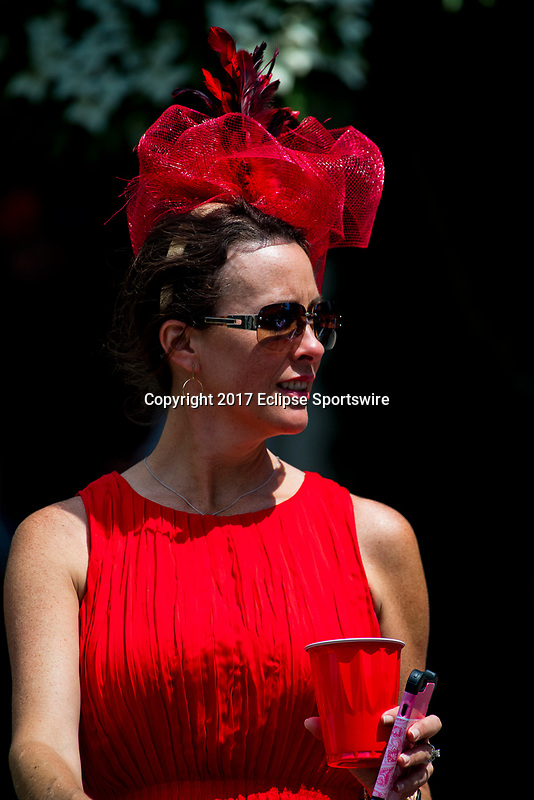ELMONT, NY - JUNE 10: A woman wears a fancy hat and all red on Belmont Stakes Day at Belmont Park on June 10, 2017 in Elmont, New York (Photo by Scott Serio/Eclipse Sportswire/Getty Images)