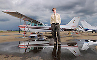 Edmonton - July 9, 2008 - Dr. Kerry Pawluski, posing for a photo at the Edmonton City Centre Airport, is a family physician who has launched a non-profit organization called Angel Flight of Alberta to provide free air transportation to families who have to travel long distances for medical treatment.