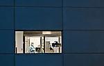 Lab technician through window