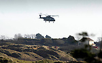 An RAF helicopter hovers over the scene of the mid air collision over Kenfig sand dunes near Porthcawl..