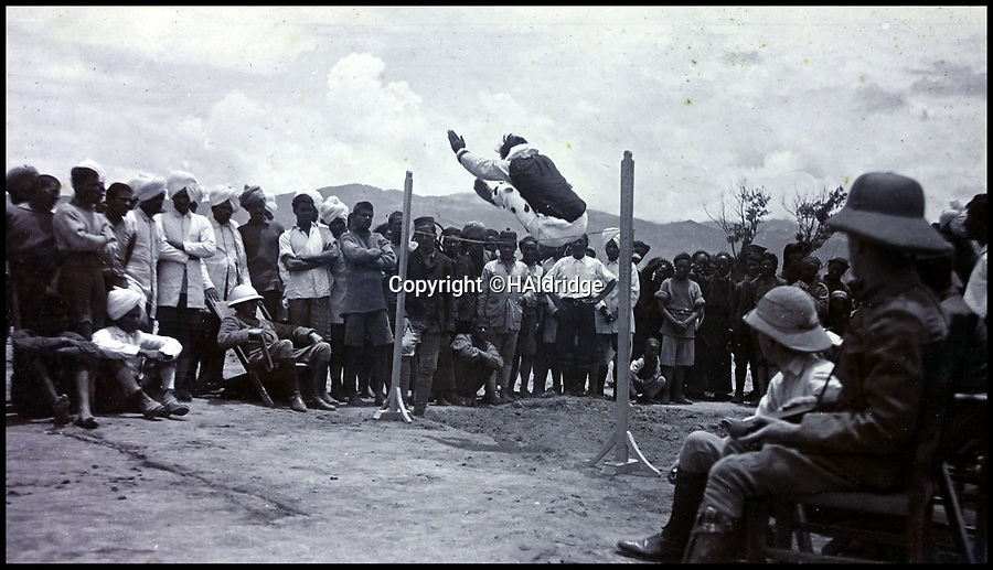 BNPS.co.uk (01202 558833)Pic: HAldridge/BNPS<br /> <br /> Big crowd for the high jump.<br /> <br /> Game tales from the hills...remarkable album shows British attempts to win over newly invaded Tibet by playing sport's straight from the playing fields of England.<br /> <br /> A collection of photos have come to light which show the people of the remote Himalayan nation of Tibet embracing one of the traditional British pastimes - a sports day.<br /> <br /> The archive of more than 500 photos was collated by a British Lieutenant Colonel, R C MacGregor, of the Indian Medical Service, who was present in Tibet between 1904 and 1912.<br /> <br /> These photos are one of the earliest examples of the British attempting to win 'the hearts and minds' of a native population as they were taken during the controversial Younghusband expedition to the distant Buddhist country.<br /> <br /> The archive also features four never before seen photos of the Dalai Lama returning to Tibet in 1912 after his exile ended.