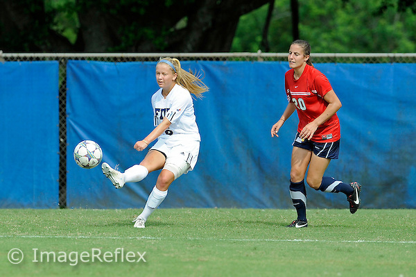 2 October 2011:  FIU midfielder/forward Nicole DiPerna (16) passes the ball while defended by South Alabama defender Tatum Perry (20) in the second half as the FIU Golden Panthers defeated the University of South Alabama Jaguars, 2-0, at University Park Stadium in Miami, Florida.