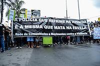Rio de Janeiro,RJ 02/07/2013 Moradores do Complexo de Favelas da Maré, na zona norte do Rio de Janeiro, realizam ato para lembrar os 10 mortos durante confronto entre o Bope e traficantes, ocorrido na semana passada. Foto : Ingrid Cristina/ Brazil Photo Press.