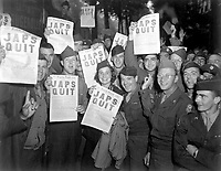 "Paris, FRANCE - August 10, 1945. - <br /> GI's at the Rainbow Corner Red Cross Club in Paris, France, whoop it up after buying the special edition of the Paris Post, which carried the banner headline, ""JAPS QUIT""."