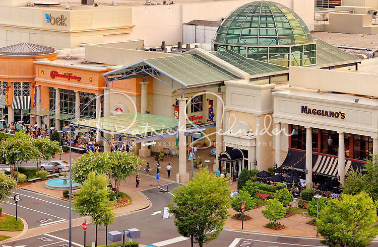 Overhead photo of SouthPark Mall in Charlotte, NC. Photo shows front of Maggiano's restaurant, The Cheesecake Factory restaurant and Belk department store, as well as the main entrance to the mall.  SouthPark Mall, owned and operated by Indianapolis-based Simon Property Group, is one of the largest and most-prestigious malls in Charlotte, North Carolina.