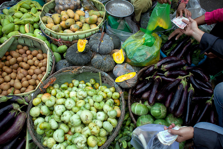 Vegetables for sale in a Marketplace in Phnom Penh, Cambodia. <br /> <br /> Photos &copy; Dennis Drenner 2013.