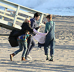 November 9th 2012  Exclusive <br /> <br /> Isabel Lucas filming the new movie Electric Slide on the beach in Malibu California <br /> holding hands with her boyfriend Angus Stone<br /> Jim Sturgess went swimming in the ocean wearing a suit for the scene.  <br /> Blonde hair pink sunglasses <br /> <br /> AbilityFilms@yahoo.com<br /> 805 427 3519<br /> www.AbilityFilms.com