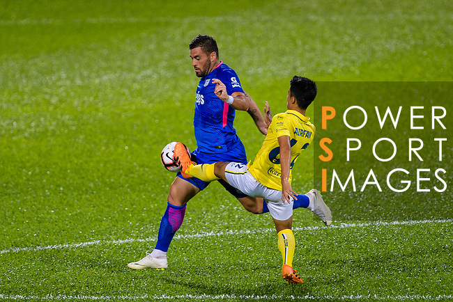 Lucas Espindola da Silva of Kitchee (L) fights for the ball with Airfan Doloh of Buriram (R) during the Preseason Friendly Match between Kitchee and Buriram United at Mong Kok Stadium on August 18, 2018 in Hong Kong. Photo by Marcio Machado/Photo by Marcio Machado/Power Sport Images