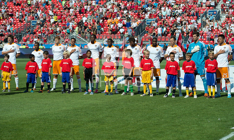 July 28, 2012: The Houston Dynamo during the national anthems in a game between Toronto FC and the Houston Dynamo at BMO Field in Toronto, Ontario Canada..The Houston Dynamo won 2-0.