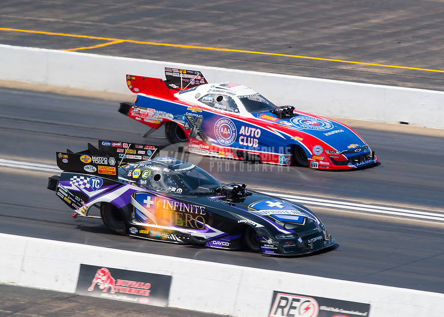 Jun 2, 2019; Joliet, IL, USA; NHRA funny car driver Jack Beckman (near)  races alongside Robert Hight during the Route 66 Nationals at Route 66 Raceway. Mandatory Credit: Mark J. Rebilas-USA TODAY Sports
