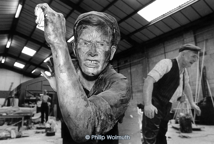 Model 'miners' being sculpted in a workshop in York, for a coal-mining museum built on the site of a disused pit in the Rhonnda Valley, South Wales. The valley was once world-famous for its coal, but all its mines are now closed. The South Wales valleys used to employ 250,000 miners in 400 pits.