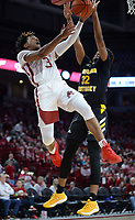 NWA Democrat-Gazette/ANDY SHUPE<br /> Arkansas guard Desi Sills (3) reaches to score Saturday, Nov. 30, 2019, as Northern Kentucky forward Dantez Walton defends during the second half of play in Bud Walton Arena. Visit nwadg.com/photos to see more photographs from the game.
