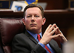 Nevada Sen. Ben Kieckhefer, R-Reno, listens to discussion on the Senate floor at the Legislative Building in Carson City, Nev., on Monday, Feb. 16, 2015. <br /> Photo by Cathleen Allison