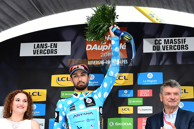 Dario Cataldo (ITA) Astana Pro Team takes over the mountains the Polka Dot Jersey on the podium with Bernard Thevenet ASO at the end of Stage 4 of the 2018 Criterium du Dauphine 2018 running 181km from Chazey sur Ain to Lans en Vercors, France. 7th June 2018.<br /> Picture: ASO/Alex Broadway | Cyclefile<br /> <br /> <br /> All photos usage must carry mandatory copyright credit (© Cyclefile | ASO/Alex Broadway)
