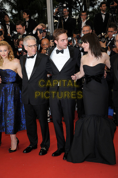 Sarah Gadon, David Cronenberg, Robert Pattinson, Juliet Binoche.'Cosmopolis' screening at the 65th  Cannes Film Festival, France..25th May 2012.full length blue strapless fishtail black white bow tie tuxedo stubble facial hair rob profile .CAP/PL.©Phil Loftus/Capital Pictures.
