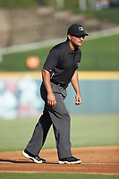 Third base umpire Charlie Ramos works the International League game between the Scranton/Wilkes-Barre RailRiders and the Gwinnett Stripers at Coolray Field on August 17, 2019 in Lawrenceville, Georgia. The Stripers defeated the RailRiders 8-7 in eleven innings. (Brian Westerholt/Four Seam Images)