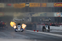 Apr. 26, 2013; Baytown, TX, USA: NHRA top fuel dragster driver Antron Brown (left) races alongside Tony Schumacher during qualifying for the Spring Nationals at Royal Purple Raceway. Mandatory Credit: Mark J. Rebilas-