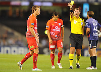 MELBOURNE, AUSTRALIA - JANUARY 23, 2010: Daniel Mullen from Adelaide United receives a yellow card in round 24 of the A-league match between Melbourne Victory and Adelaide United FC at Etihad Stadium on January 23, 2010 in Melbourne, Australia. Photo Sydney Low www.syd-low.com