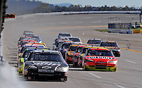 Nov. 1, 2009; Talladega, AL, USA; NASCAR Sprint Cup Series driver Dale Earnhardt Jr (left) leads a line of cars while Jeff Gordon leads the inside line down the backstretch during the Amp Energy 500 at the Talladega Superspeedway. Mandatory Credit: Mark J. Rebilas-
