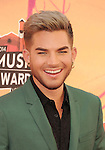 LOS ANGELES, CA- MAY 01: Singer Adam Lambert attends the 2014 iHeartRadio Music Awards held at The Shrine Auditorium on May 1, 2014 in Los Angeles, California.