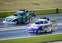 Sept. 23, 2012; Ennis, TX, USA: NHRA funny car driver Matt Hagan (near lane) races alongside John Force during the Fall Nationals at the Texas Motorplex. Mandatory Credit: Mark J. Rebilas-US PRESSWIRE