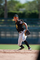 Pittsburgh Pirates shortstop Ji-Hwan Bae (56) throws to first base during a Florida Instructional League game against the Baltimore Orioles on September 22, 2018 at Ed Smith Stadium in Sarasota, Florida.  (Mike Janes/Four Seam Images)