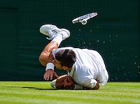 England, London, 27.06.2014. Tennis, Wimbledon, AELTC, Novak Djokovic (SRB) falls on the grass and hurts his shoulder <br /> Photo: Tennisimages/Henk Koster