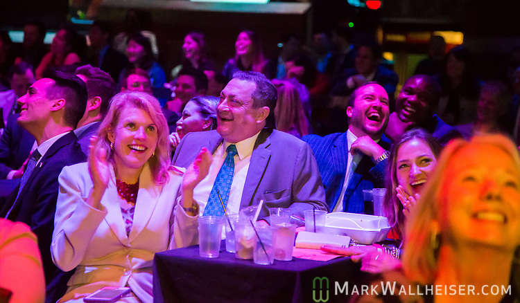 The audience laughs during the 62nd Annual Press Skits 2017, The Crony Awards, sponsored by the Florida Capitol Press Corps, held at The Moon in Tallahassee, Florida March 14, 2017.  The funds raised go to the Barbara Frye Scholarship Fund supporting Florida journalism students attending Florida schools.