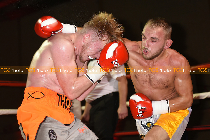 Thomas Kindon (orange/grey shorts) defeats Craig Derbyshire during a Boxing Show at Tolworth Recreation Centre on 29th October 2016