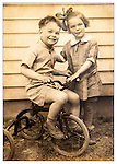 Brother and sister with bicycle. 1930's