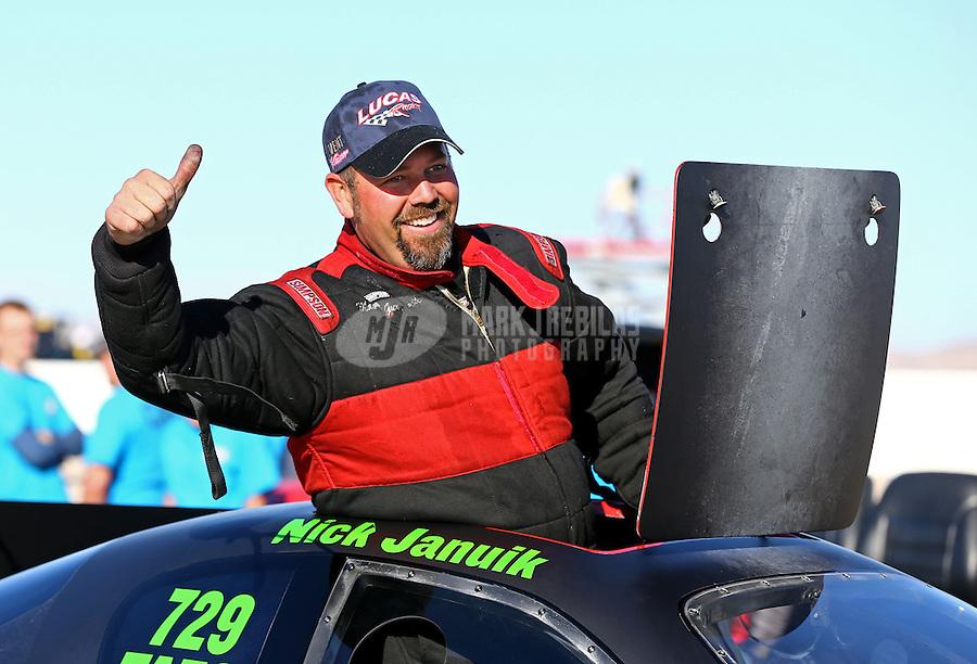 Mar 30, 2014; Las Vegas, NV, USA; NHRA top alcohol funny car driver Nicholas Januik celebrates after winning the Summitracing.com Nationals at The Strip at Las Vegas Motor Speedway. Mandatory Credit: Mark J. Rebilas-