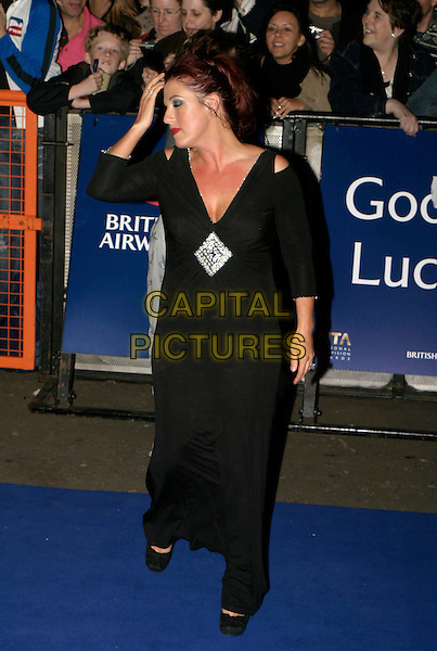 JESSE WALLACE.Leaving The National Television Awards 2005 at the Royal Albert Hall, London, UK..October 25th, 2005.Ref: AH.full length black dress red chest sunburn profile.www.capitalpictures.com.sales@capitalpictures.com.© Capital Pictures.