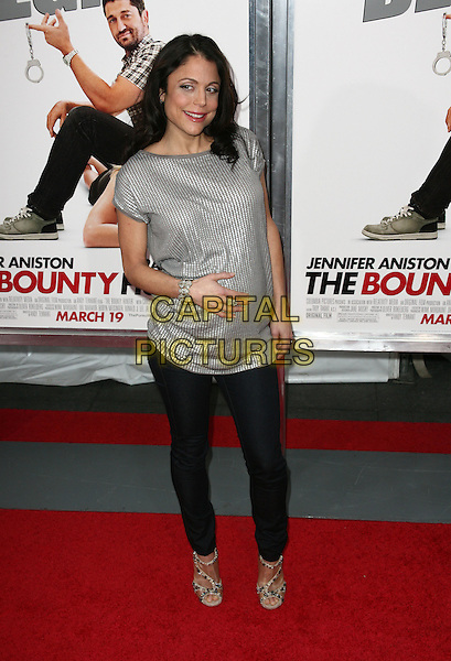 BETHENNY FRANKEL.New York City. New York City premiere of 'The Bounty Hunter' at Ziegfeld Theatre on March 16, 2010 in New York City, New York , NY, USA..March 16th, 2010.full length black jeans denim grey gray silver top pregnant hand on stomach.CAP/ADM/PZ.©Paul Zimmerman/AdMedia/Capital Pictures.