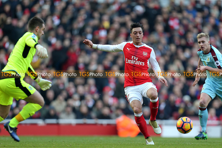 Mesut Ozil of Arsenal tries to beat Thomas Heaton of Burnley during Arsenal vs Burnley, Premier League Football at the Emirates Stadium on 22nd January 2017