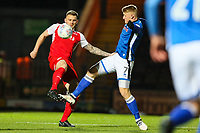 Lewis Coyle of Fleetwood Town clears away from Stephen Humphrys of Rochdale during the Sky Bet League 1 match between Rochdale and Fleetwood Town at Spotland Stadium, Rochdale, England on 20 March 2018. Photo by Thomas Gadd.