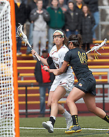 Boston College midfielder Cali Ceglarski (23) on the attack. University of Maryland defender Iliana Sanza (14) defends..University of Maryland (black) defeated Boston College (white), 13-5, on the Newton Campus Lacrosse Field at Boston College, on March 16, 2013.