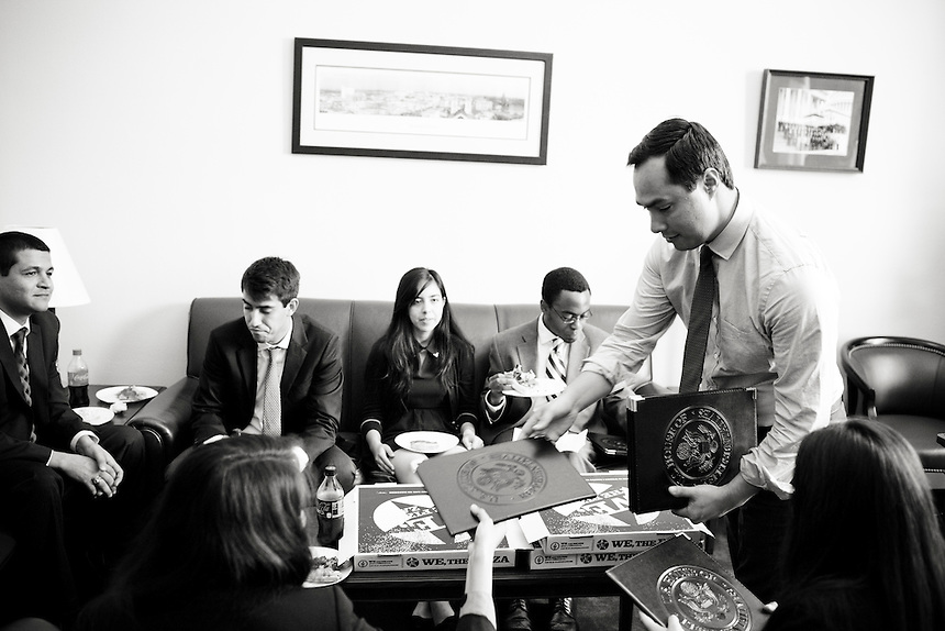 Freshman  Congressman, United States Representative Joaqin Castro from San Antonio, Texas gives portfolio notebooks to his departing interns at his office in the Cannon Building in Washington, DC on July 24, 2013. CREDIT: Lance Rosenfield/Prime