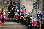 © Joel Goodman - 07973 332324 . 02/09/2013 . Bury , UK . Fire service personnel line the route up to the church . The funeral of fireman Stephen Hunt at Bury Parish Church today (Tuesday 3rd September 2013) . Stephen Hunt died whilst tackling a blaze at Paul's Hair World in Manchester City Centre in July 2013 . Photo credit : Joel Goodman