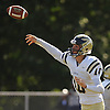 Mike Conforti #10 of Baldwin completes a pass to TJ Salvatore (not pictured) for a 52-yard gain during the second quarter of a Nassau County Conference I varsity football game against host Hempstead High School on Saturday, Sept. 17, 2016. Baldwin won by a score of 36-28.