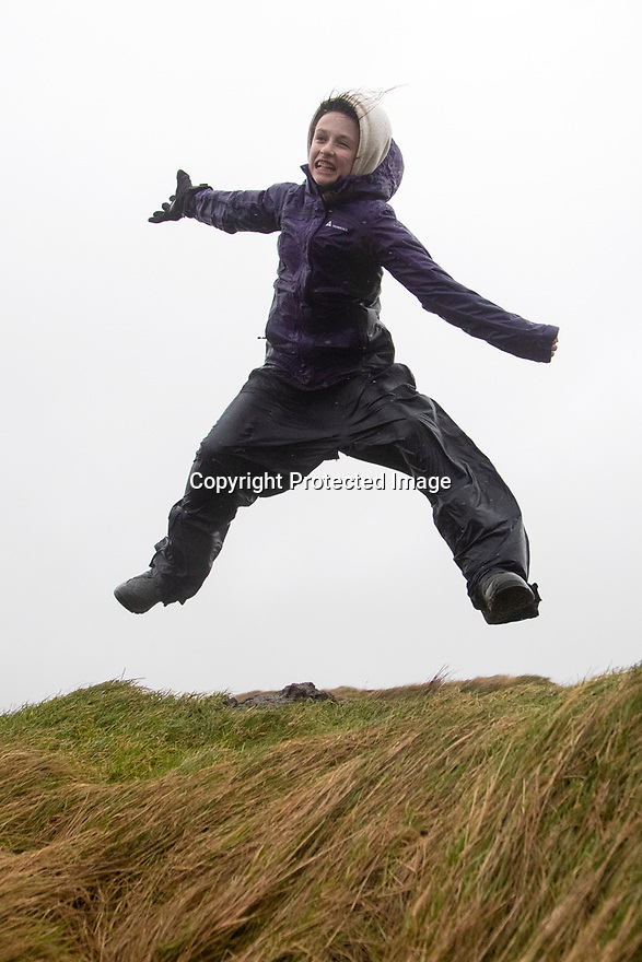 15/02/120<br /> <br /> Freya Kirkpatrick, 12, plays in storm force winds high up on the Staffordshire Moorlands near Flash in the Peak District as Storm Dennis begins to hit the UK.<br /> <br /> All Rights Reserved: F Stop Press Ltd.  <br /> +44 (0)7765 242650 www.fstoppress.com