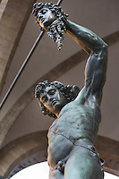 View from below of statue of Perseus holding the Head of Medusa, 1554, by Benvenuto Cellini, and Palazzo Vecchio, Piazza de la Signoria, Florence, Tuscany, Italy, pictured on June 8, 2007, in the afternoon. The statue was commissioned by Cosimo I de Medici and has recently been restored. Florence, capital of Tuscany, is world famous for its Renaissance art and architecture. Its historical centre was declared a UNESCO World Heritage Site in 1982. Picture by Manuel Cohen.